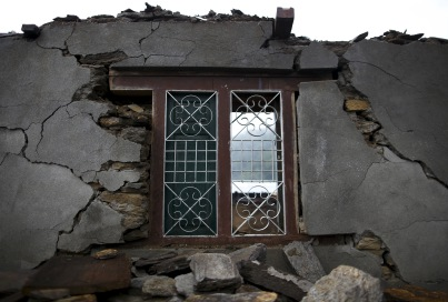 A remaining window of a collapsed house is pictured after an earthquake at Barpak village
